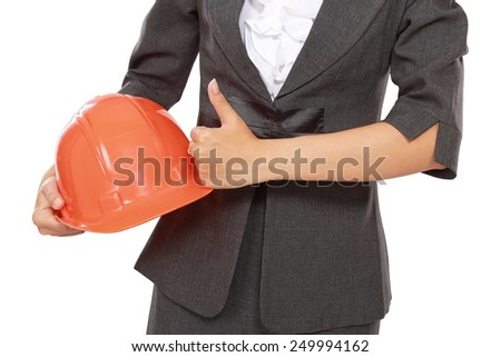 businessman hand carrying a helmet and shows thumb up, isolated on white background - stock photo