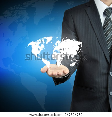 Businessman hand carrying world map  -  worldwide services, rule the world, world domination concepts etc. - stock photo