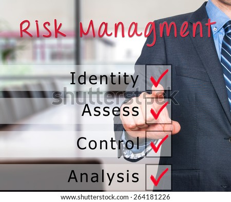 Businessman hand checking the checklist boxes risk management identity assess control analysis by pen on transparent glass. Isolated on office background. Stock Iamge - stock photo