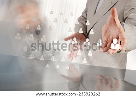 businessman hand choosing people icon as human resources concept  - stock photo
