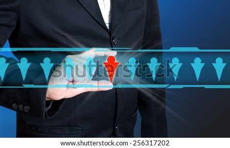 Businessman hand choosing people icon as human, resources concept - stock photo