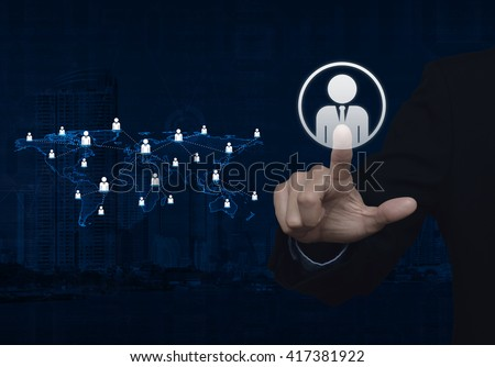 Businessman hand click businessman icon with light blue world map connection on city tower, Elements of this image furnished by NASA