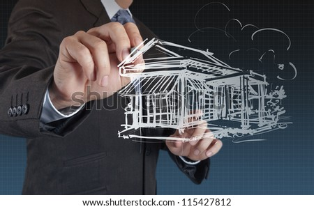 businessman hand draw house - stock photo