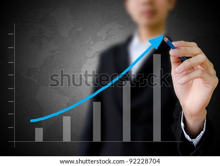businessman hand drawing a graph. - stock photo