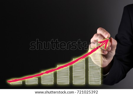 Businessman hand drawing a graph with red arrow