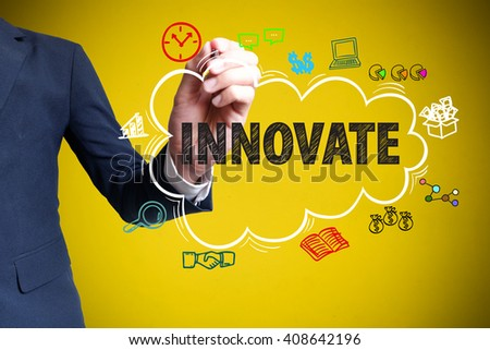businessman hand drawing cloud with icon cartoon and writing INNOVATE  on yellow background , business concept , business idea - stock photo