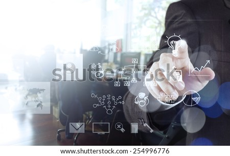 businessman hand drawing creative business strategy with light bulb as concept and bokeh exposure - stock photo