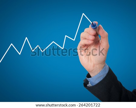 Businessman hand drawing graph of growth. Isolated on blue background. Stock Image - stock photo