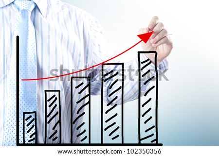 Businessman hand drawing the increase graph. Concept for growth, profit and gain - stock photo