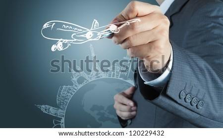 businessman hand draws airplane travel around the world - stock photo