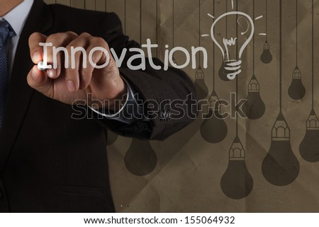 businessman hand draws innovation  light bulb with recycle envelope background as creative concept - stock photo