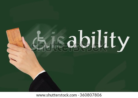 Businessman hand erased  disability word on blackboard change to  Ability. - stock photo