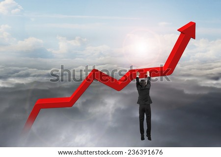 businessman hand hanging on red trend chart with natural sky daylight cloudscape background - stock photo