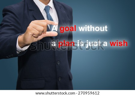 Businessman hand holding A goal without a plan is just a wish - stock photo