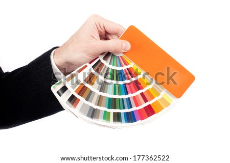 businessman hand holding a pantone palette on a white background - stock photo