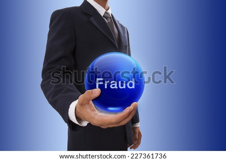 Businessman hand holding blue crystal ball with fraud word. - stock photo