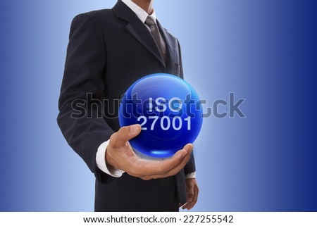 Businessman hand holding blue crystal ball with iso 27001 word.  - stock photo