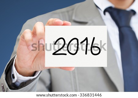 Businessman hand holding card with 2016 message. - stock photo