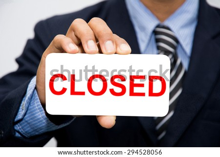 Businessman hand holding closed concept - stock photo