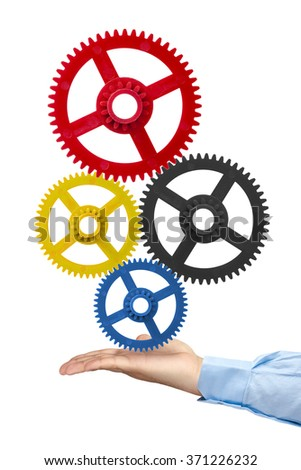 Businessman hand holding gears isolated - stock photo