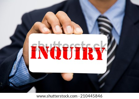 Businessman hand holding INQUIRY concept  - stock photo