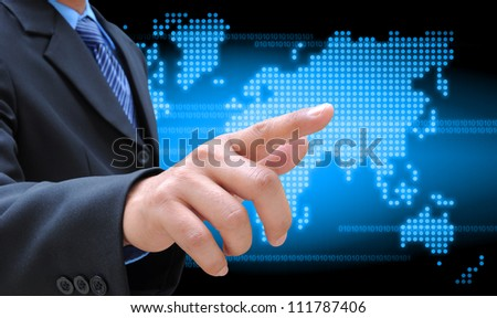 businessman hand holding on technology - stock photo