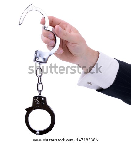 businessman hand holding out handcuffs isolated on white