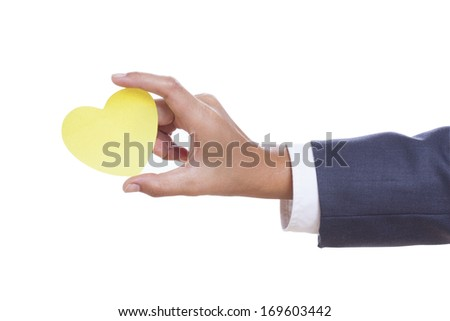 Businessman hand holding paper heart, isolated on white background. - stock photo