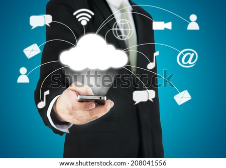Businessman hand holding smart phone cloud connectivity on blue background