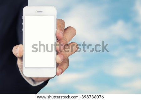 Businessman hand Holding Smartphone with blue sky background on screen.lifestyle concept  - stock photo
