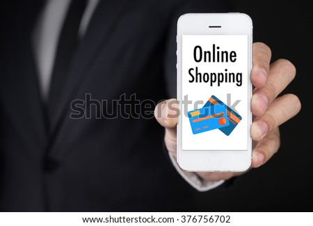 Businessman hand Holding Smartphone with Online Shopping on screen.lifestyle concept  - stock photo