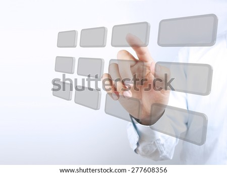 Businessman hand is pointing the visual button on the transparent virtual screen.