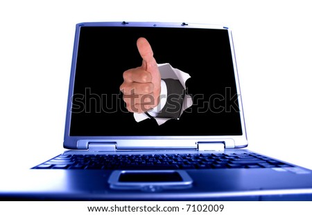 businessman hand OK in the hole on laptop