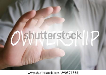 businessman hand, ownership - stock photo