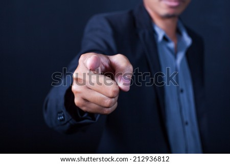 Businessman hand pointing - stock photo
