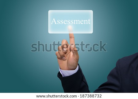 Businessman hand pointing assessment. - stock photo