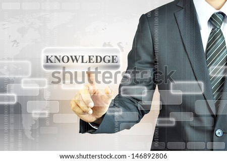 Businessman hand pointing KNOWLEDGE sign - stock photo
