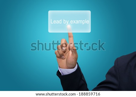 Businessman hand pointing Lead by example - stock photo
