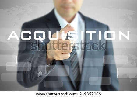 Businessman hand pointing on ACQUISITION word on virtual screen - stock photo