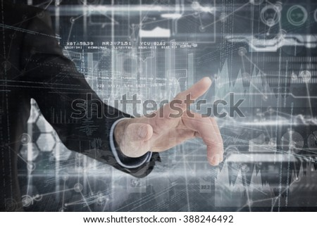 Businessman hand pointing something against hologram background - stock photo