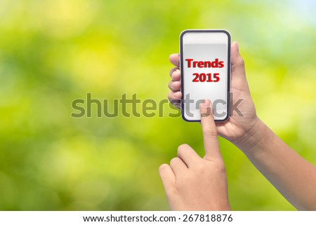 Businessman hand pointing Trends 2015 - stock photo
