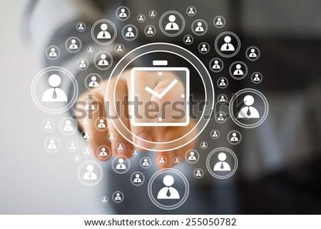 Businessman hand press clock time button - stock photo