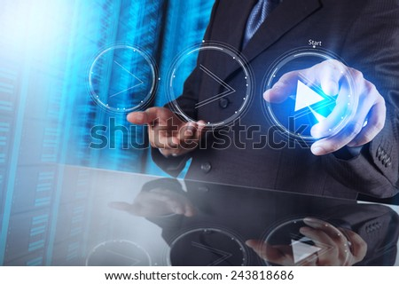 businessman hand press play button sign to start or initiate projects as concept  - stock photo