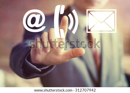 Businessman hand press telephone button mail - stock photo