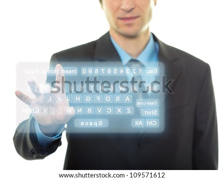 Businessman Hand pushing a button on a virtual keyboard - stock photo