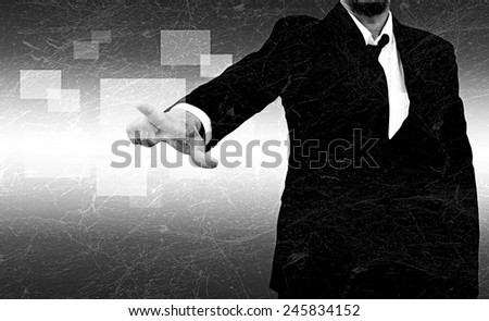 businessman hand pushing button on a touch screen interface in the old texture - stock photo