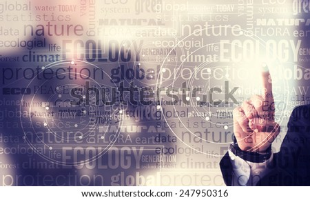 Businessman hand pushing button on touch screen interface - stock photo