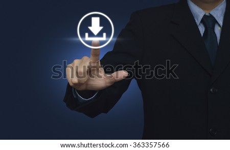Businessman hand pushing button web download icon over blue background - stock photo