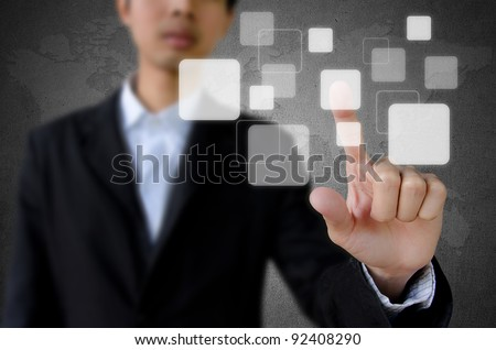 businessman hand pushing button with touch screen interface - stock photo