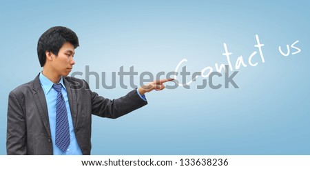 businessman hand pushing contact us - stock photo